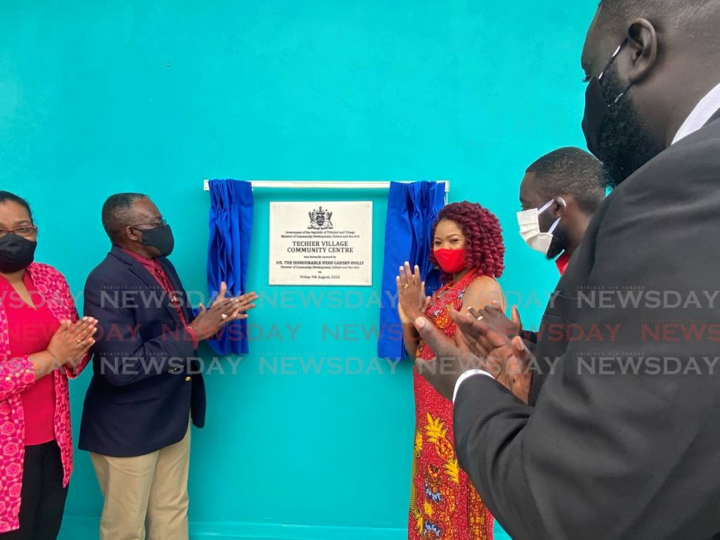Minister of Social Development, Culture and the Arts Dr Nyan Gadsby-Dolly and Housing Minister Edmund Dillon unveil the commemorative plaque at the opening ceremony for the TYechier Community Centre in Point Fortin on Friday. Looking on are Point Fortin mayor Kennedy Richards Jr, Techier/Guapo councillor Lyndon Harris,and Gwyneth Morris-Alexander, deputy director, Community Development Division.  - Narissa Fraser