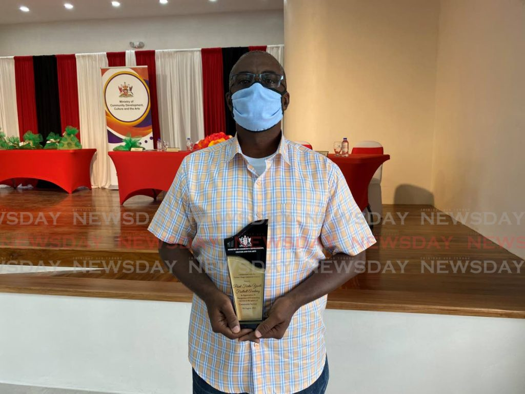 President of the Point Fortin Youth Football Academy Nester Price poses with his award for community service, awarded to him by the Ministry of Social Development, Culture and the Arts on Friday.  PHOTO BY NARISSA FRASER. - Narissa Fraser