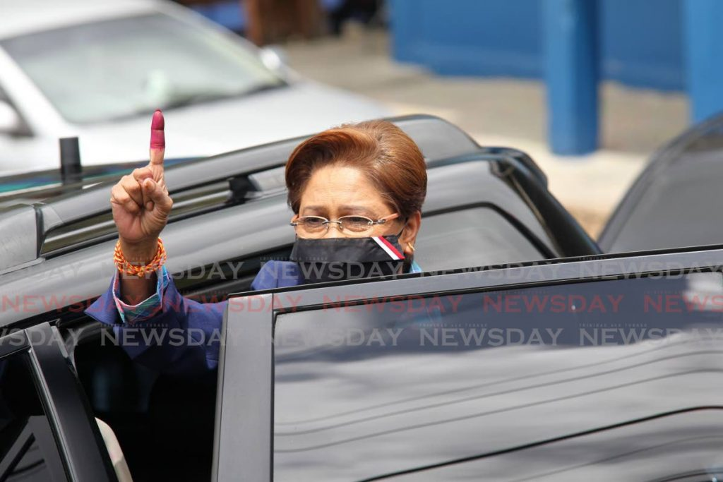 UNC political leader Kamla Persad Bissessar shows her voting finger to supporters as she left the Hermitage Presbyterian school after voting in the 2020 General Elections. - Lincoln Holder