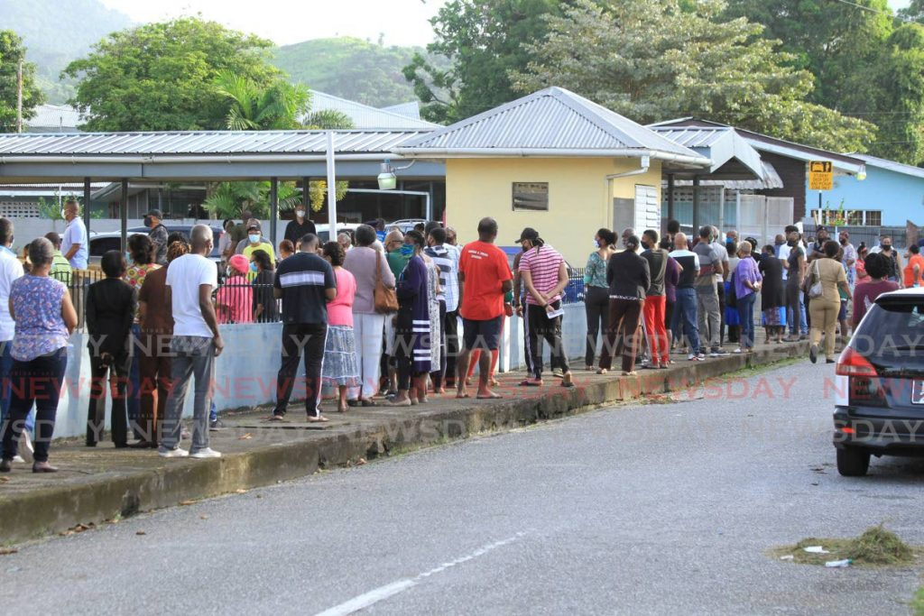 Voters wait in long lines to enter a school in Arouca during Monday's general election. A political backlash with many inflammatory and racist comments on social media has led Christian churches to speak out against racism in TT. - Ayanna Kinsale