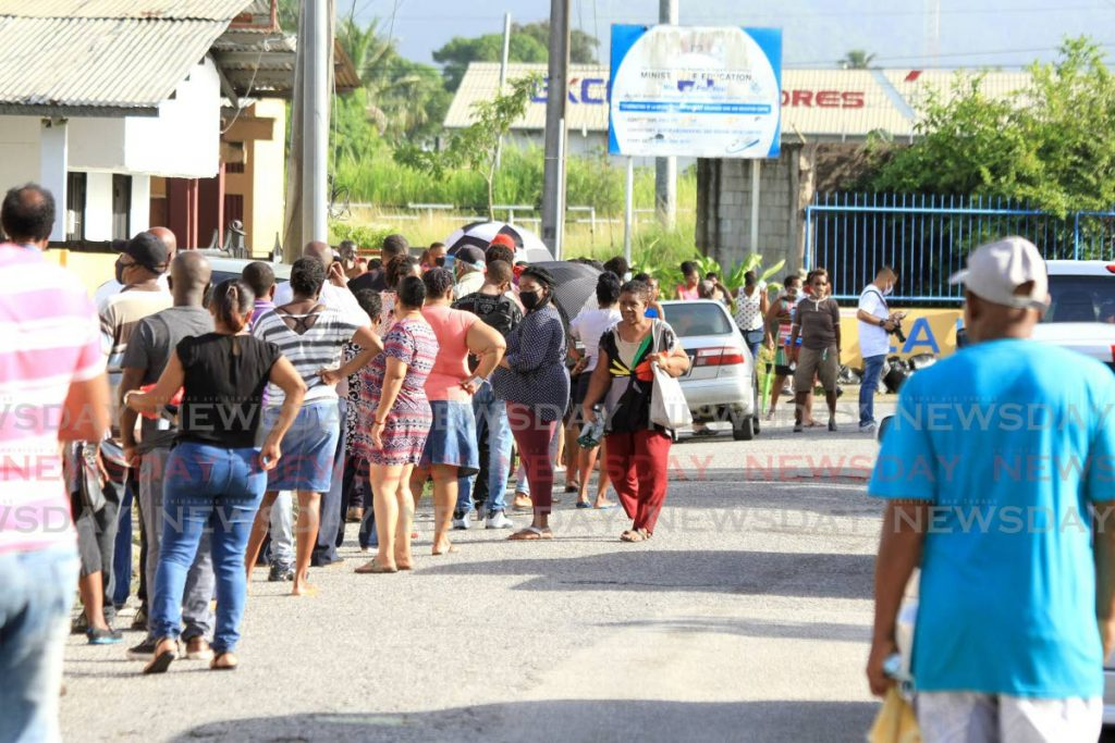 Voters wait in a long line to vote at the La Horquetta South Government Primary School on Monday - Ayanna Kinsale