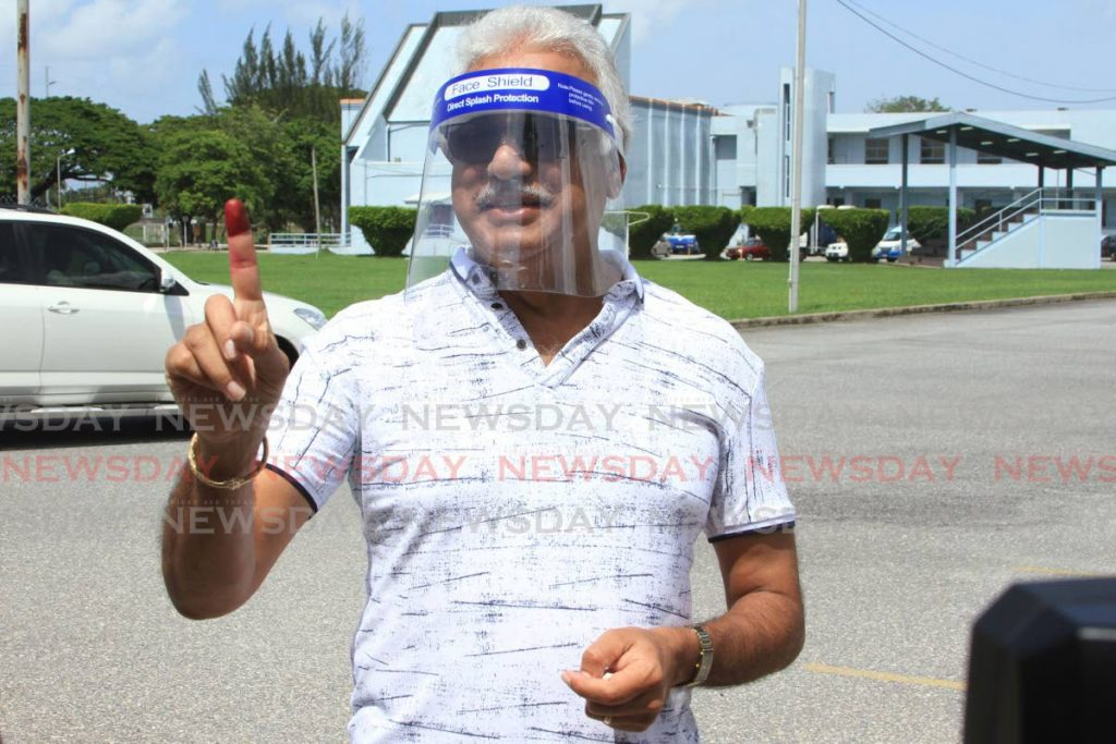 Minister of Health Terrence Deyalsingh shows his finger after voting at the Cipriani College of Labour & Co-Operative Studies on the Churchill Roosevelt Highway, Valsayn. - Ayanna Kinsale