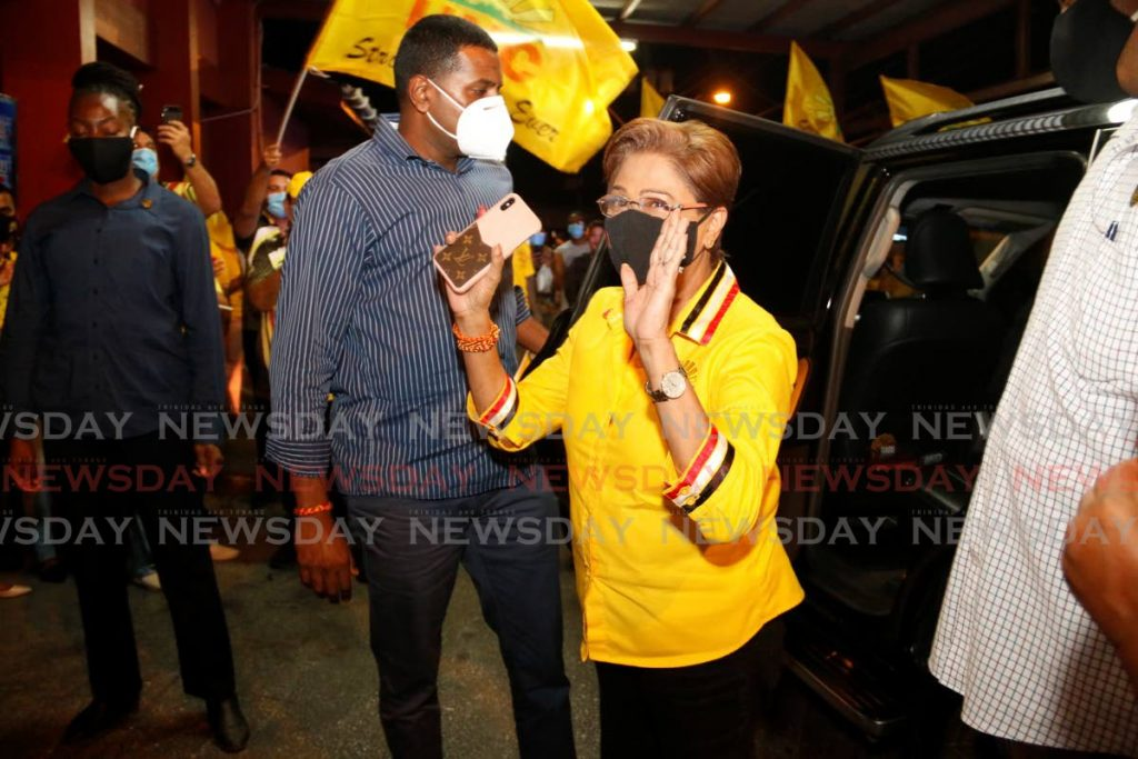 UNC Political Leader Kamla Persad-Bissessar arrives at her constituency office in Siparia on Monday night. - Marvin Hamilton