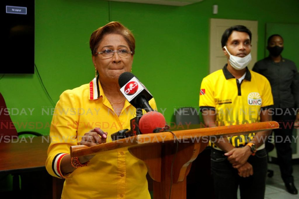UNC political leader Kamla Persad Bissessar makes a speech from her constituency office in Siparia on Monday Night as MP-elect for Princes Town Barry Padarath looks on. - Marvin Hamilton