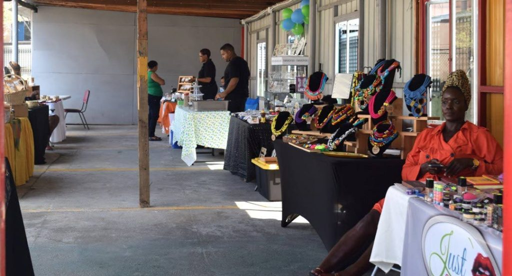 Vendors Collaborative member Natalie Howe of DE-COLLE-TE sits with creations during a pop-up shop. -