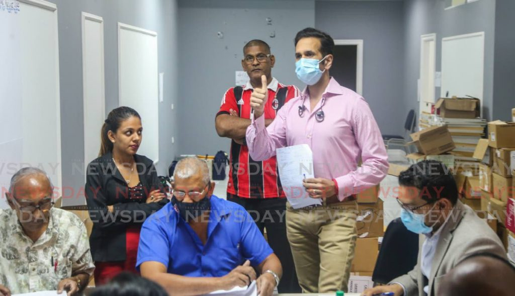 San Fernando West candidate Faris Al Wari gives the thumbs up as he was declared the winner once again at the end of the recount done by returning officer Eddison Ramdeen at the RBC office, Cipero Street. - Jeff Mayers