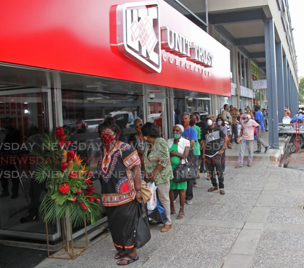 File photo: Customers wait in line to enter the Unit Trust Corporation's new office at Carlton Centre, San Fernando on July 1.