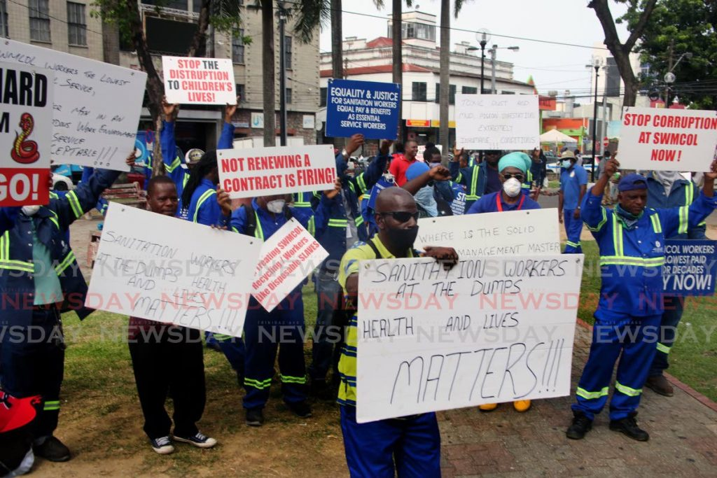 In this photo taken in July, workers of the TT Solid Waste Management Company (SWMCOL) protest on Independence Square, Port of Spain over outstanding wages negotiations. The Movement for Social Justice's manifesto includes job creation, decent pay and proper conditions of work among its economic proposals.  PHOTO BY SUREASH CHOLAI - SUREASH CHOLAI