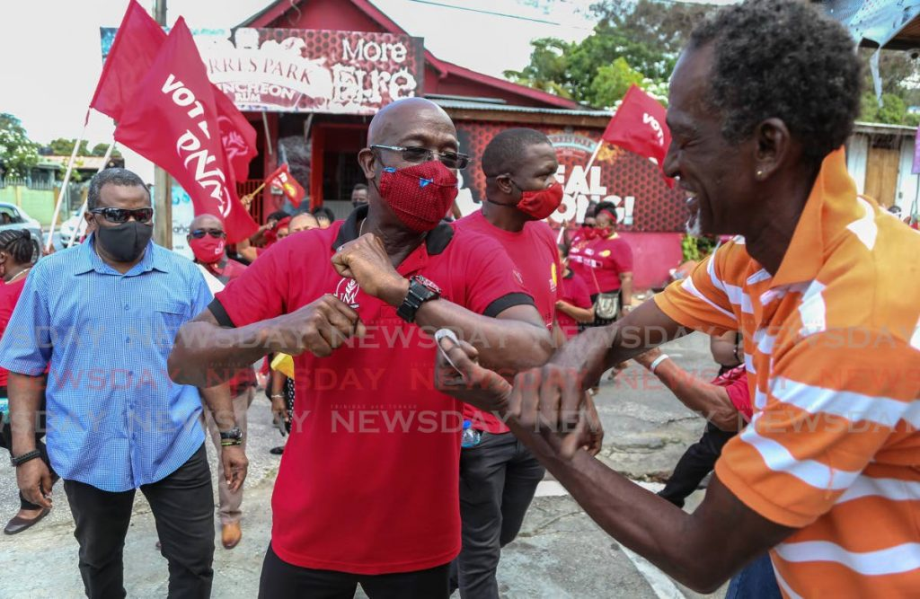 PNM leader Dr Keith Rowley greets a supporter in Point Cumana on nomination day on July 17. PHOTO BY JEFF MAYERS -