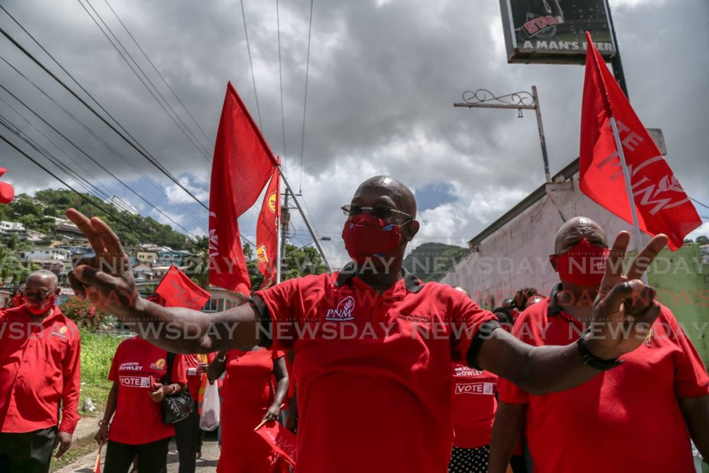 PNM political leader Dr Keith Rowley walks with supporters after filing his nomination papers on July 17. PHOTO BY JEFF MAYERS -