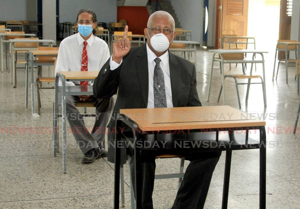 In this photo taken on June 24, Education Minister Anthony Garcia and Gerald Thomas, principal of the Aranguez North Secondary school, show the media seating arrangements for students in classrooms.  - Ayanna Kinsale
