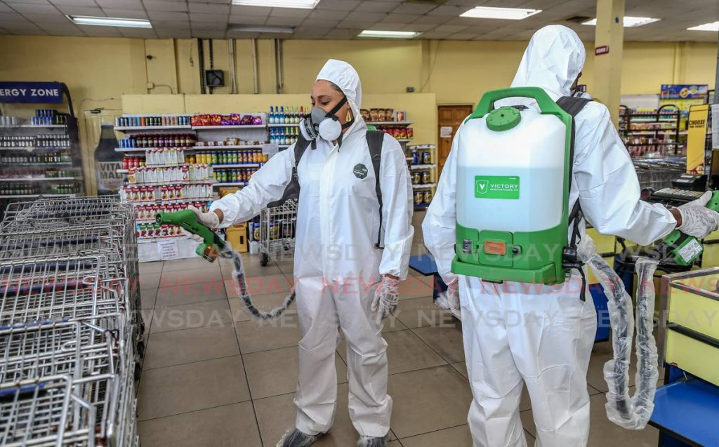 In this July 24, 2020 file photo, Trinidad Innovation technicians sanitise inside Ramish and Leela supermarket, San Juan after a report a customer had covid19.   PHOTO BY JEFF MAYERS -