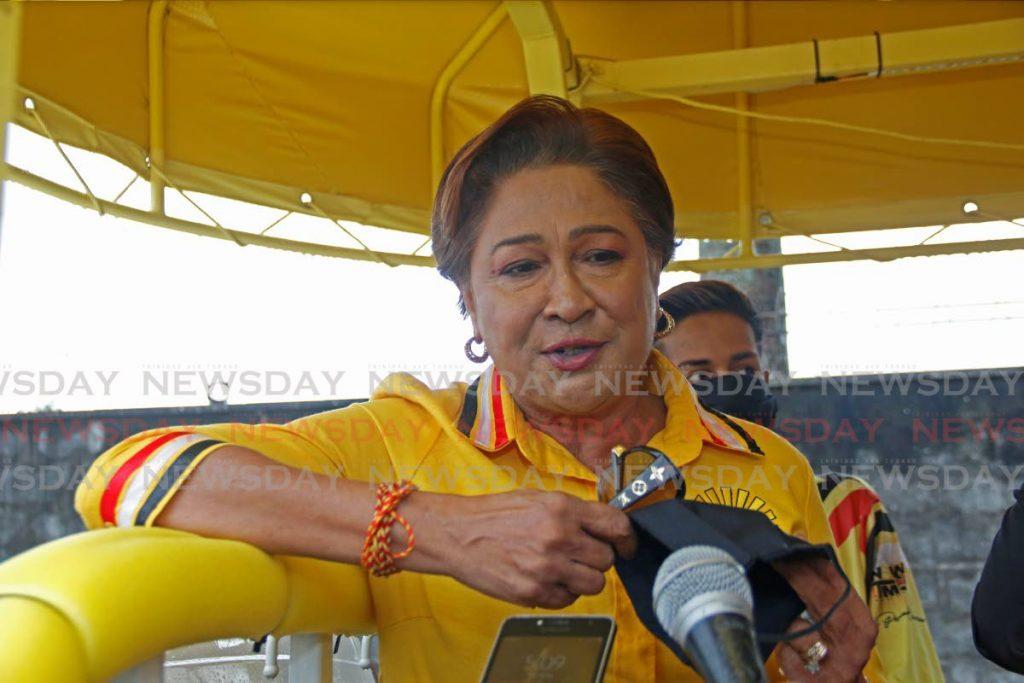 UNC political leader Kamla Persad-Bissessar during a motorcade in central Trinidad on July 29.  - Marvin Hamilton