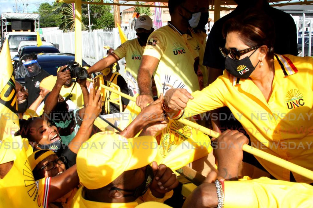 UNC leader Kamla Persad-Bissessar greets supporters on a motorcade from Morvant to Diego Martin on Friday. PHOTO BY ROGER JACOB -