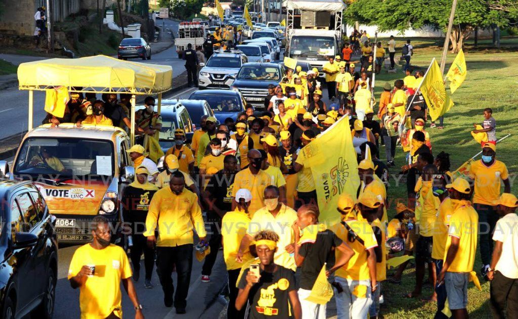 A crowd of UNC supporters move along the Eastern Main Road in Laventille during a motorcade from Morvant to Diego Martin on Friday. PHOTO BY ROGER JACOB -