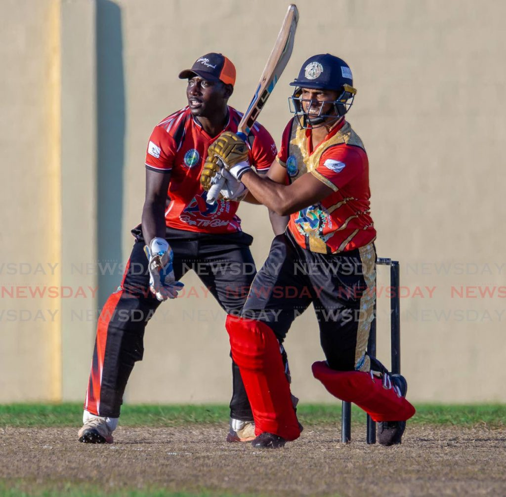 Chief Secretary XI batsman Nicholas Pooran on the attack against the All Stars XI at the Cyd Gray Sporting Complex, Roxborough on Friday. - DAVID REID