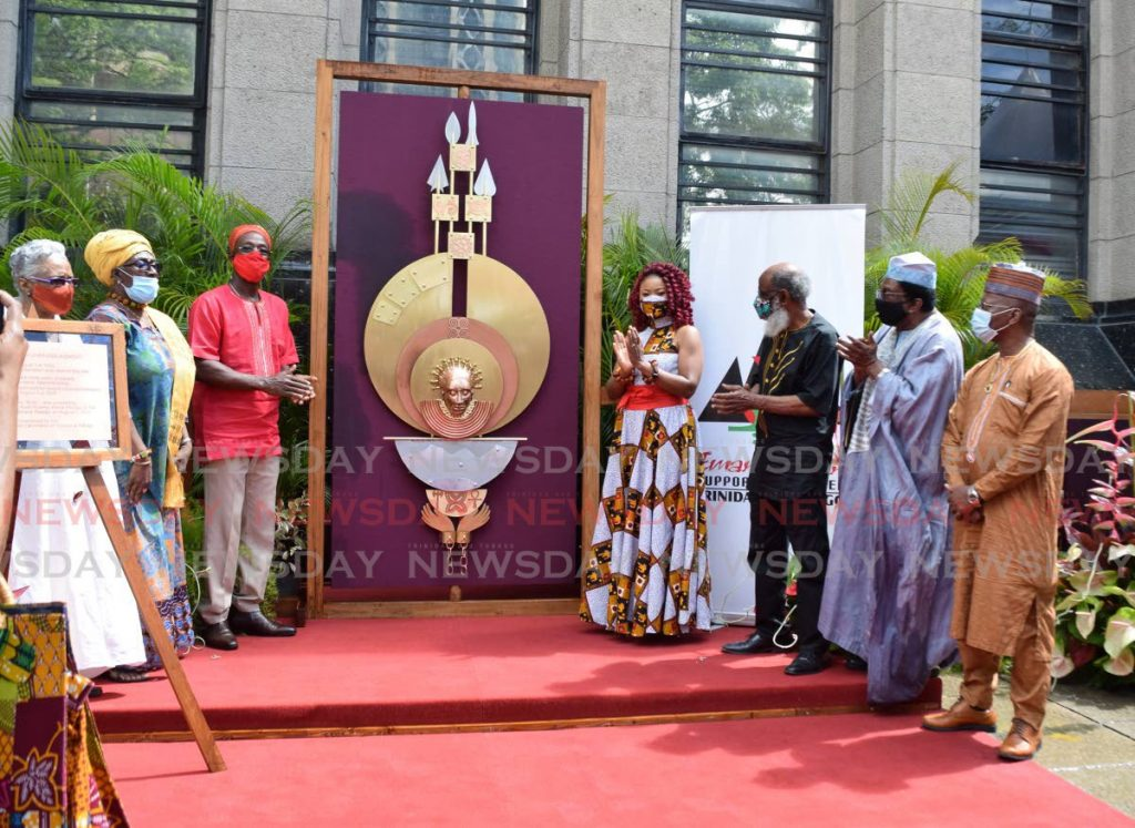 Prime Minister Dr Keith Rowley and Minister of Community Development,Culture and the Arts Dr Nyan Gadsby-Dolly and members of the Emancipation Support Committee of TT unveil the monument to commemorate the end of slavery at Treasury Building, Port of Spain on Saturday morning.  PHOTO BY VIDYA THURAB -