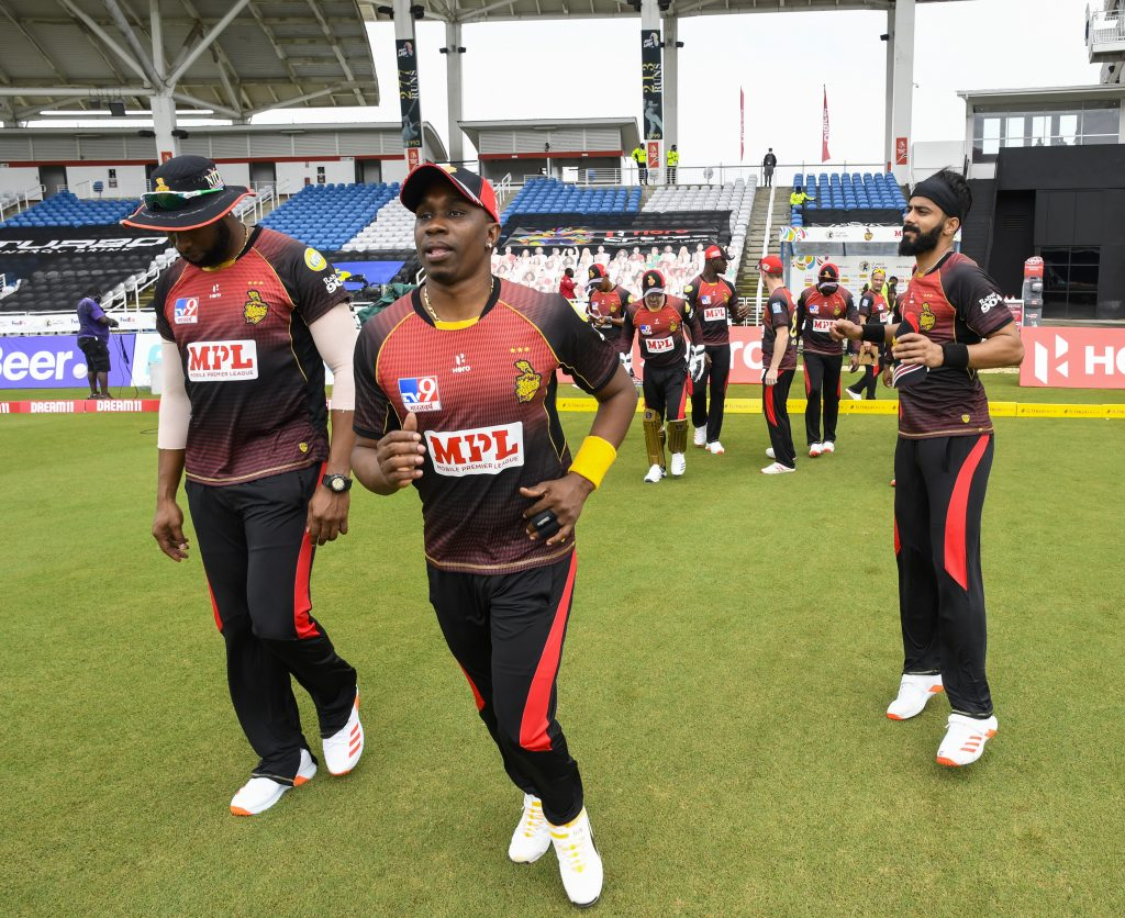 Trinbago Knight Riders players take the field for the opening match of the 2020 Hero Caribbean Premier League against Guyana Amazon Warriors on Tuesday at the Brian Lara Cricket Academy in Tarouba. PHOTO BY CPL T20