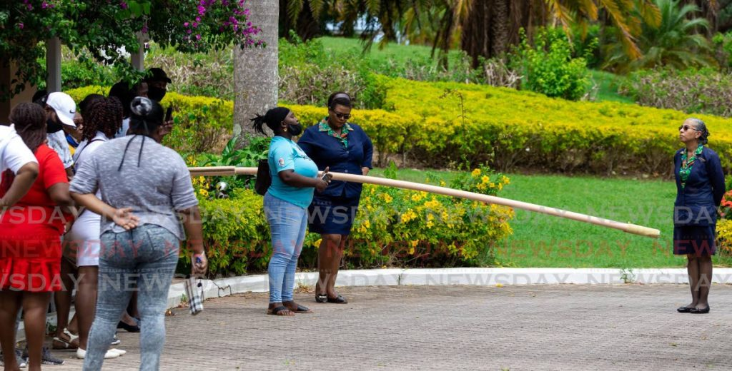 Coco Reef Resort & Spa manager Rachel-Anne Mc Sween, right, chats with disgruntled workers last month after they were told they would be laid off until October. PHOTO BY DAVID REID -