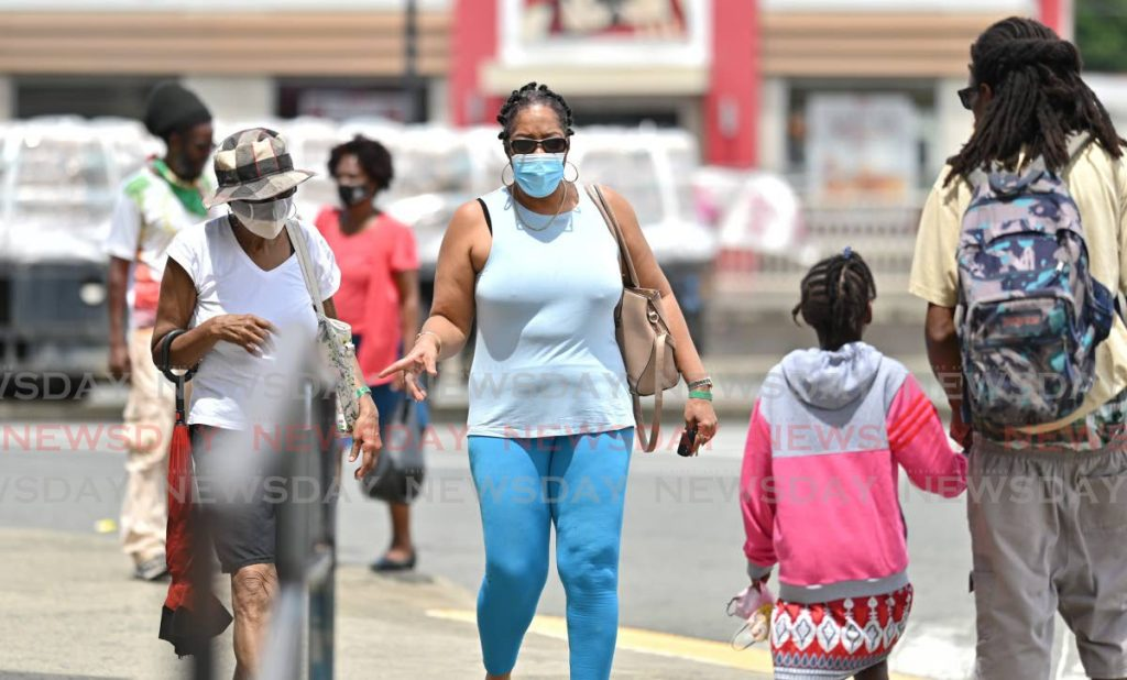 KEEPING SAFE: Two women walk through downtown Scarborough with their masks on last month. A new law, which went into effect on Monday, made mask wearing mandatory.  - LEEANDRO NORAY