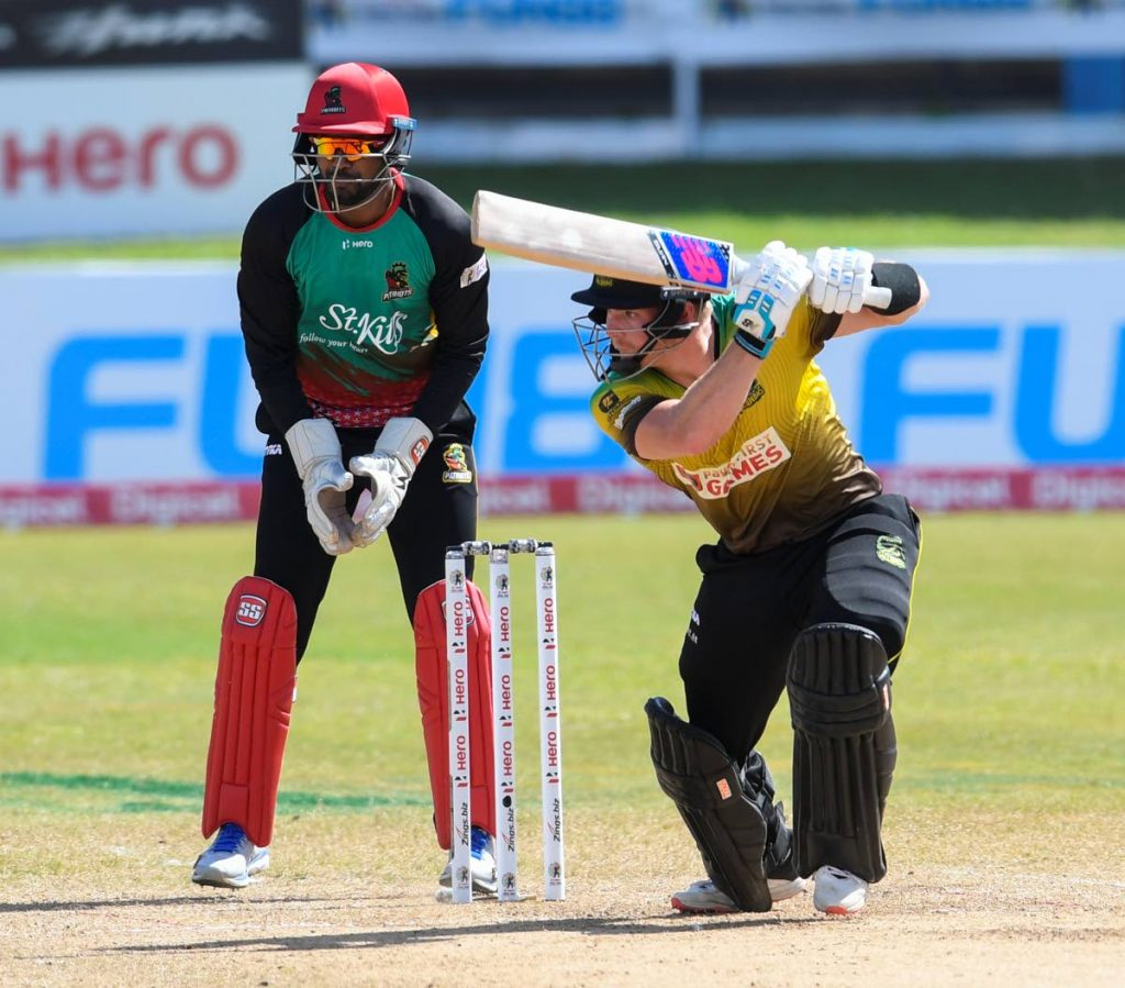 Glenn Phillips (right) of Jamaica Tallawahs hits a four as Denesh Ramdin (left) of St Kitts & Nevis Patriots watches during the Hero Caribbean Premier League match 18 between St Kitts & Nevis Patriots and Jamaica Tallawahs at the Queen's Park Oval, St Clair on August 29.  -