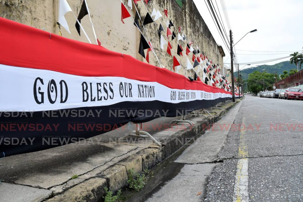 MAIN PIC: Even as decorations line Frederick Street on Monday, the road and sidewalk, usually filled with people celebrating a national milestone, remain deserted on Independence Day as covid19 restrictions are enforced. - Vidya Thurab