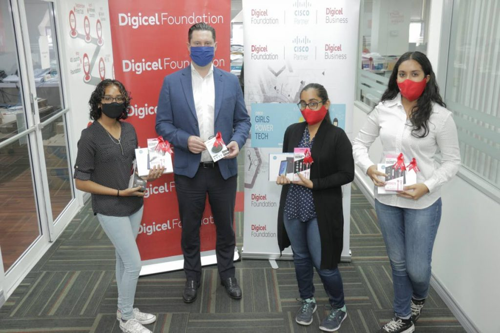 The second-placed team, Tech Girls, proudly display prizes. From left are Danara Sahadeo, Digicel Business general manager Liam Donnelly, Karishma Ramsamooj and Shreya Rajpaulsingh. - Photo courtesy Digicel Foundation