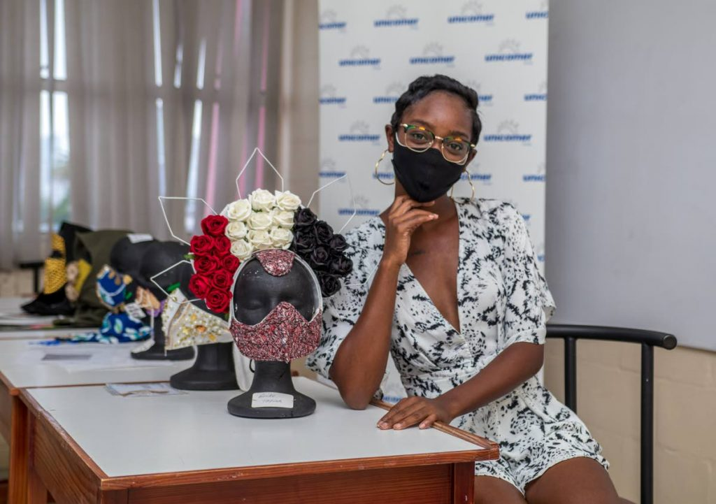 Anike Taylor of the Port of Spain Fashion Week/University of TT (UTT) Face Mask Challenge with her winning design. -