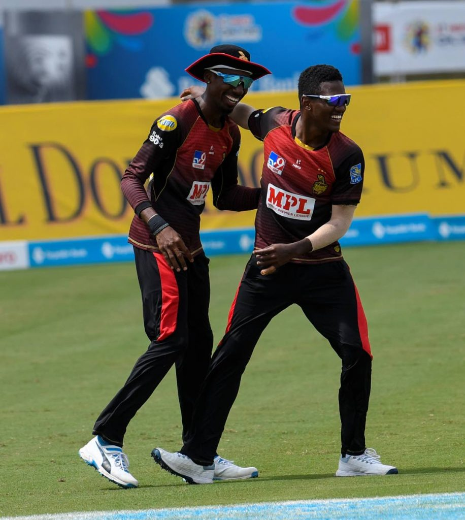Khary Pierre (left) and Akeal Hosein of Trinbago Knight Riders celebrate the dismissal of Alzarri Joseph of St Kitts/Nevis Patriots during the teams' Hero Caribbean Premier League match 23 at the Brian Lara Cricket Academy, Tarouba on Wednesday. (Photo by CPL T20 via Getty Images) -