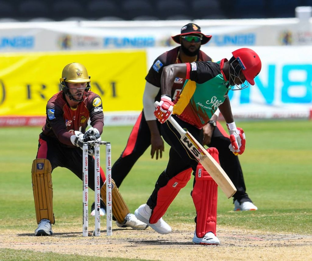 Colin Archibald (right) of St Kitts/Nevis Patriots is stumped by wicket-keeper Tim Seifert (left) of Trinbago Knight Riders during the teams' Hero Caribbean Premier League match 29 at the Brian Lara Cricket Academy on Sunday in Tarouba. (Photo by CPL T20 via Getty Images) -