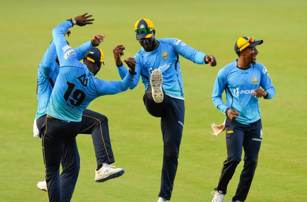 Darren Sammy (second from right), Kesrick Williams (second from left) and Kavem Hodge (right) of St Lucia Zouks celebrate the dismissal of Andre Russell of Jamaica Tallawahs during the teams' Hero Caribbean Premier League match 30 at the Brian Lara Cricket Academy on Sunday in Tarouba. (Photo by CPL T20 via Getty Images) -