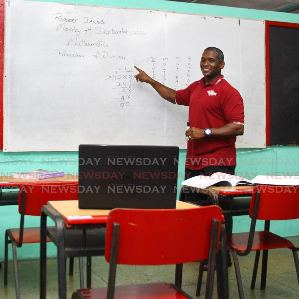 Robert Jacob, standard four teacher of the Barataria Anglican Primary School, conducts an online orientation and revision class with his pupils during the first day of online classes at his school on Monday. - ROGER JACOB