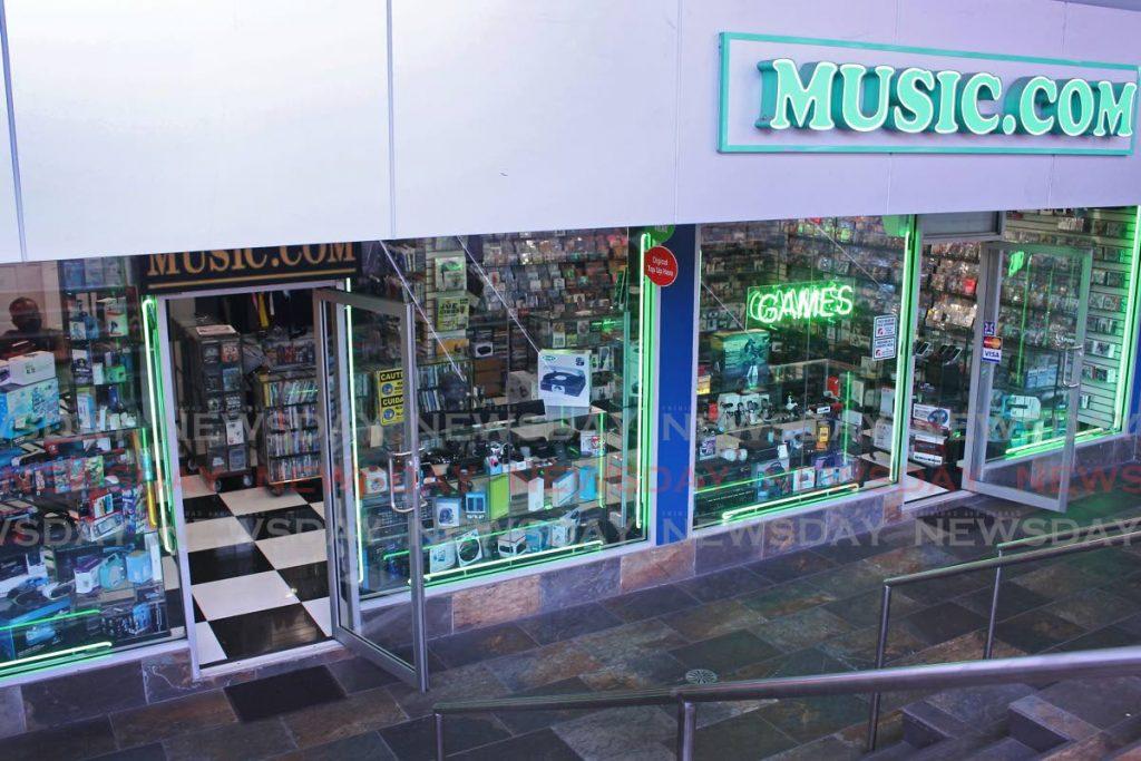 Management of MUSIC.COM in Calton Centre, High Street await new stocks in await of the new school term starting next week. - CHEQUANA WHEELER