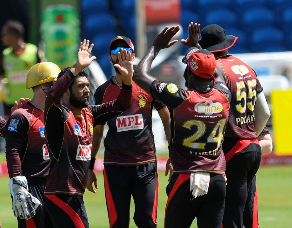Sikandar Raza (L) of Trinbago Knight Riders celebrates the dismissal of Evin Lewis of St Kitts & Nevis Patriots during the Hero Caribbean Premier League match 29 between St Kitts & Nevis Patriots and Trinbago Knight Riders at Brian Lara Cricket Academy,Tarouba, on Sunday.  - CPL T20 via Getty Images