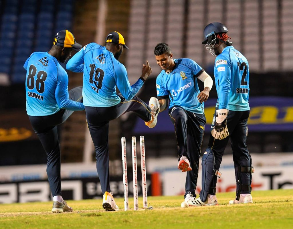 Mark Deyal (second from right) of St Lucia Zouks celebrates the dismissal of Chanderpaul Hemraj of Guyana Amazon Warriors during the Hero Caribbean Premier League semi-final match on Tuesday at the Brian Lara Cricket Academy. Tarouba. Also in photo are Zouks captain Darren Sammy (left), Kesrick Williams (second from left) and Andre Fletcher. (Photo by CPL T20 via Getty Images) -