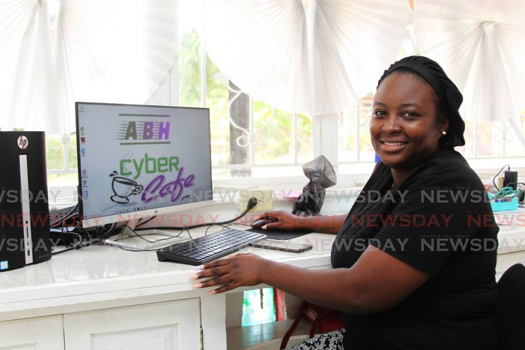 Daeja Young has opened up ABH Cyber Cafe, Moruga Road, Basse Terre, for children to use computers for online lessons.   - PHOTOS BY LINCOLN HOLDER