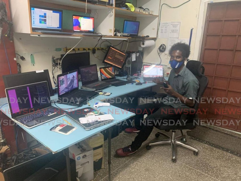 IT technician Ryan Pierre at work at Laptop Nation on Wednesday. -