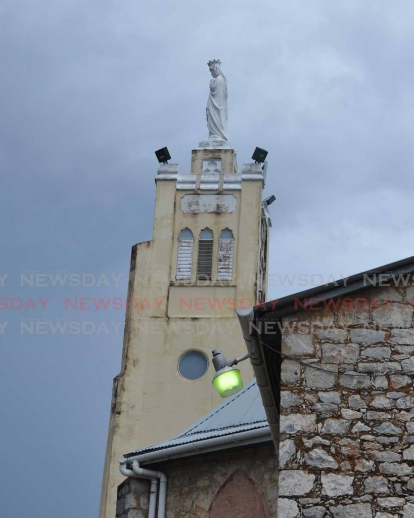 Marian statue atop Laventille Shrine  before lightning struck and damaged the statue. - Photos courtesy the Catholic News