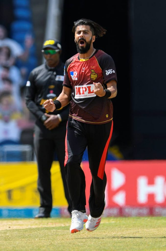 Ali Khan of Trinbago Knight Riders celebrates the dismissal of Rahkeem Cornwall of St Lucia Zouks during the Hero Caribbean Premier League final, at Brian Lara Cricket Academy, on Thursday. - CPL T20 via Getty Images
