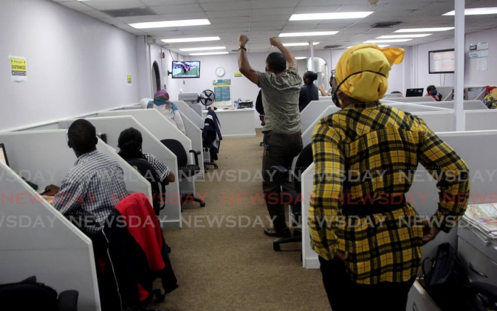 Even Newsday workers joined in the celebration as the match ended. - SUREASH CHOLAI