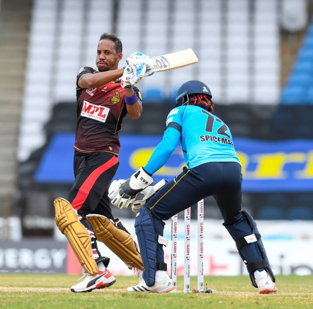 Lendl Simmons (L) of Trinbago Knight Riders hits a four during the Hero Caribbean Premier League final, at Brian Lara Cricket Academy,Tarouba, on Thursday.  - CPL T20 via Getty Images