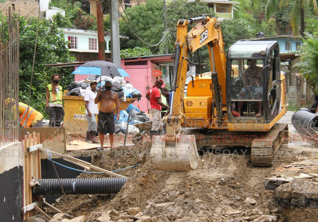 Construction workers repair a road after it collapsed at La Seiva, Maraval. - Ayanna Kinsale