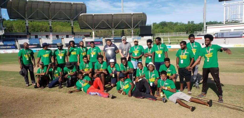 BLCA facilities manager Haresh Ragoonath and CPL pitch consultant  Dave Agnew, centre L-R, celebrate the successful hosting of this year's CPL  T20 tournament with the hardworking groundsmen and cover staff of the south venue. -