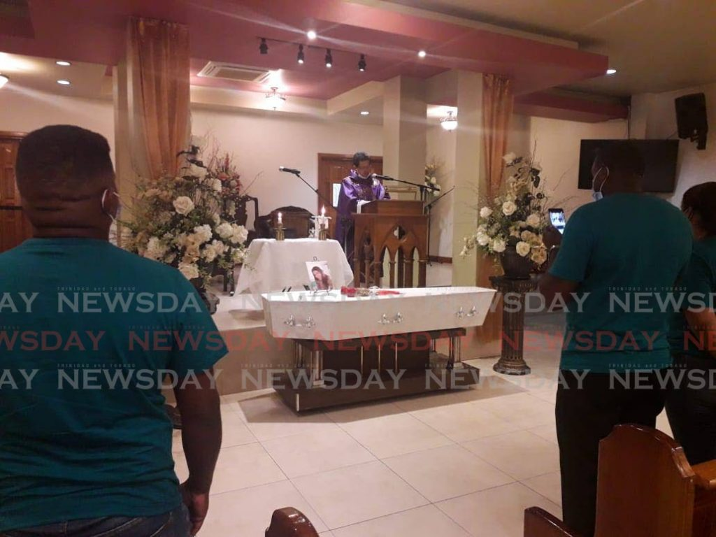 Mourners at the  funeral of Joanna Sanchez at JE Guide Funeral Home and Crematorium in San Fernando on Friday.   -