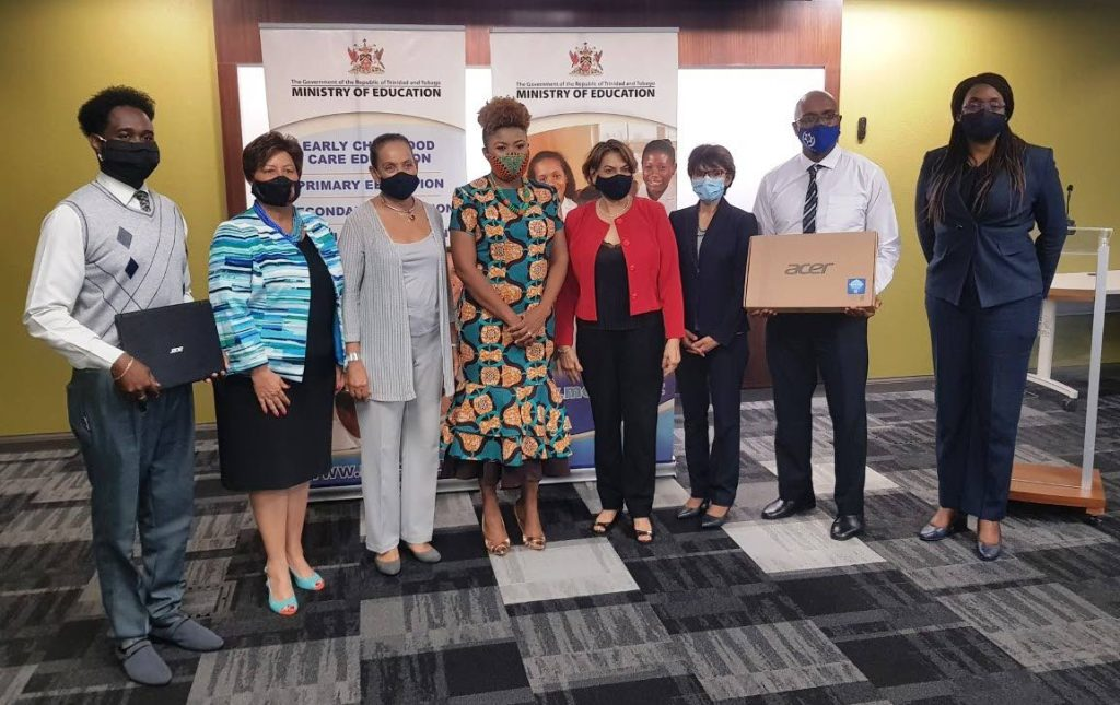 Education Minister Dr Nyan Gadsby-Dolly, centre, Ministry of Education officials, principals and representatives from Women in Action for the Needy and Destitute. Photo courtesy Ministry of Education. -