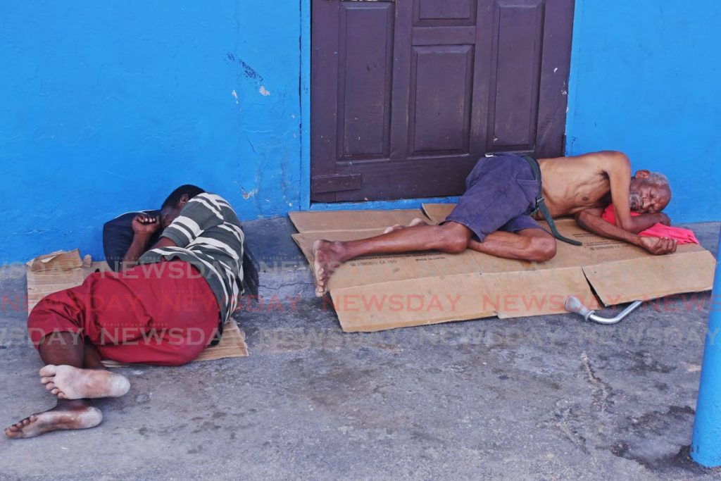 Homeless men sleep near the San Fernando Police Station on Harris Promenade on Saturday. - CHEQUANA WHEELER