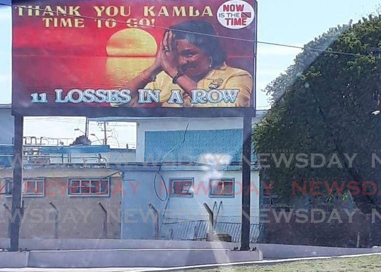 A billboard calling for the resignation of UNC leader Kamla Persad-Bissessar as party leader.  -