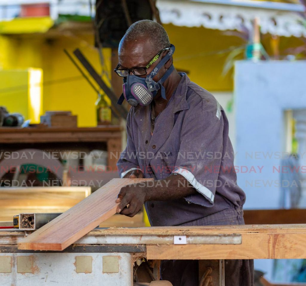 Gerald Moses builds desks for students at Gaskin Road, Bon Accord workshop. - DAVID REID