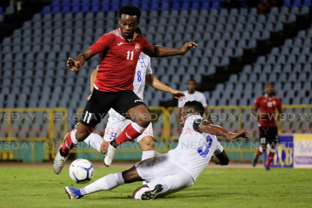 TT's Levi Garcia, left, in a 2019 Concacaf Nations League match at the Hasely Crawford Stadium, Mucurapo. Garcia signed for AEK Athens in Greece on a five-year deal. - AFP