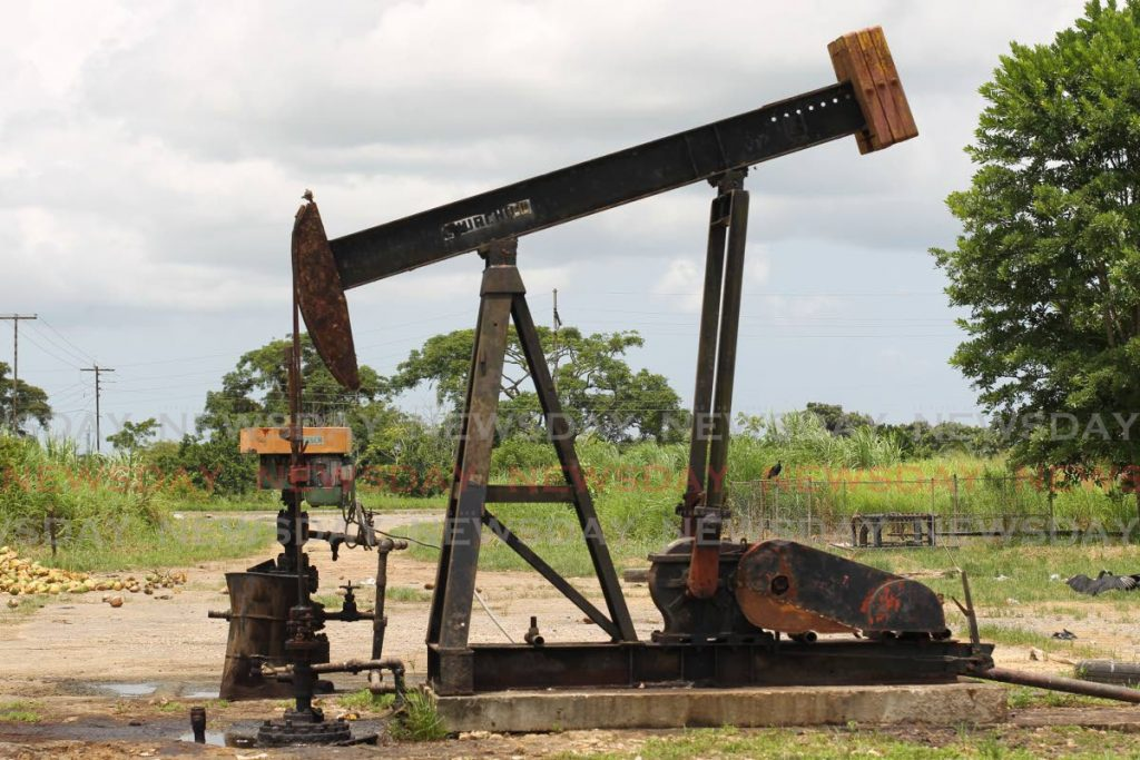 An oil pumping jack at Wilson road, Penal. The Central Bank in its latest economic bulletin has suggested the country cannot put all eggs into the energy sector as global declines are likely to continue for years.   - Lincoln Holder